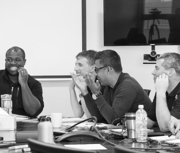Black and white photo of a team meeting