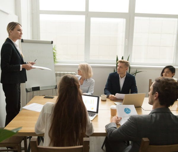 Business coach mentor teaching employees at company training
