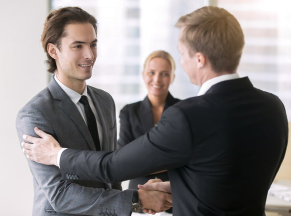 Two businessmen handshaking