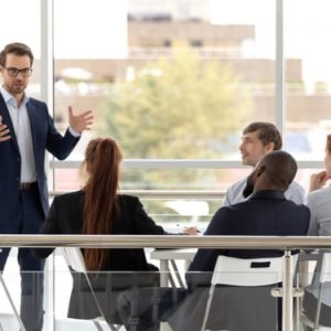 Successful coach businessman presenting new project to employee