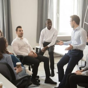 Employees having an informal briefing at workplace
