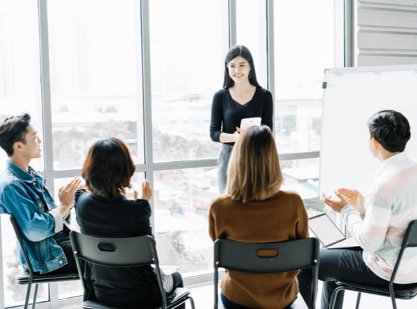 Woman coaching and teaching in modern office