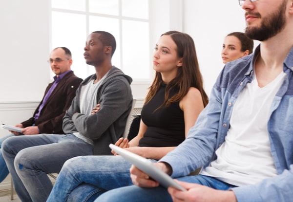 Group Of People Sitting At Seminar