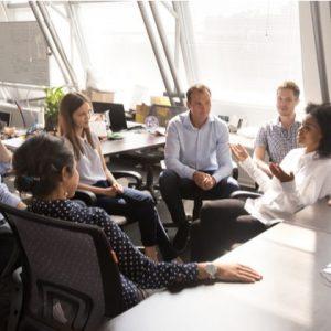 Female leader speaking to team interns