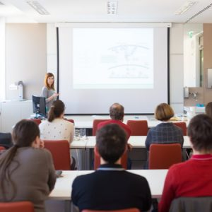 Speaker giving presentation in lecture hall