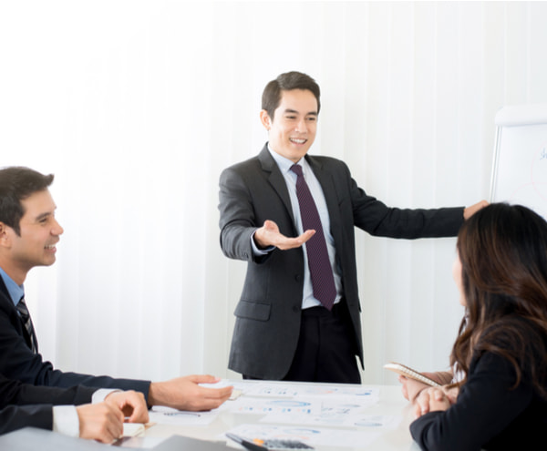Businessman as a meeting leader giving presentation in meeting room