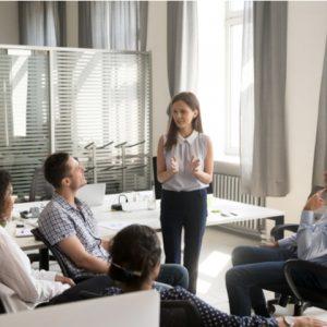 Woman speak at group briefing in coworking space