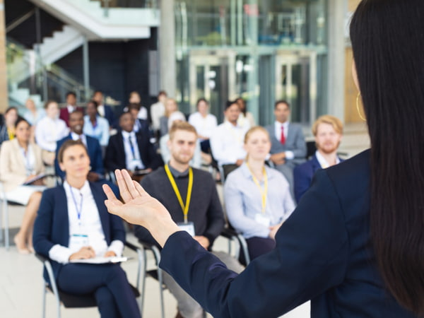 Businesswoman doing speech in conference room