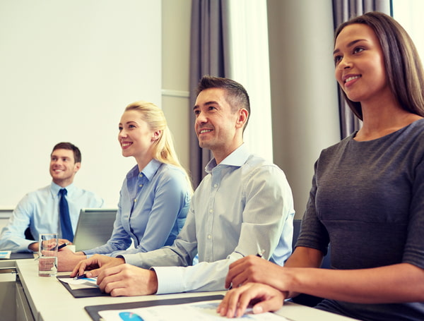 Smiling business team in meeting