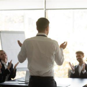Back view of successful businessman make speech