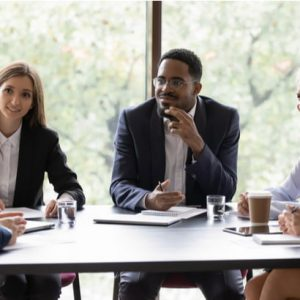 CEO talking at group meeting in office boardroom