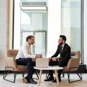 Businessmen discussing deal
