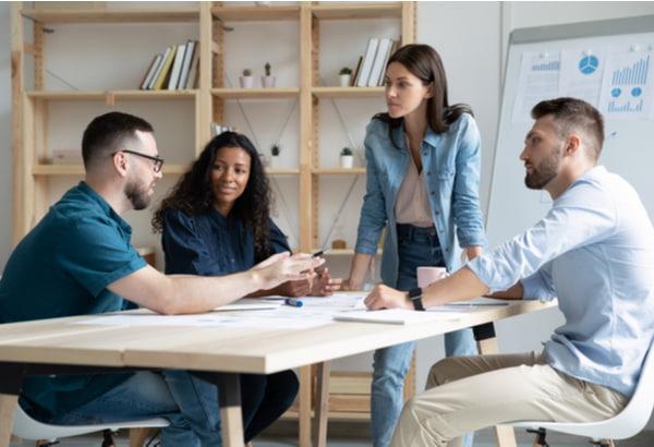 Team leader listening to skilled coworker