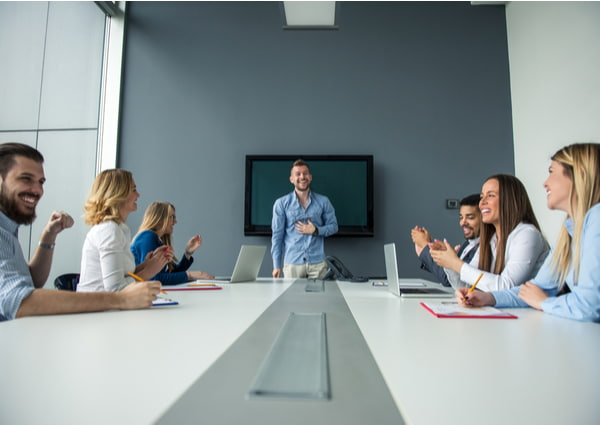 Man presenting ideas to the rest of the team