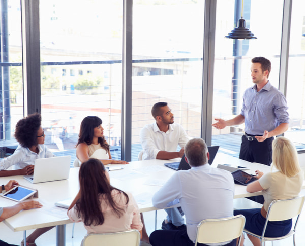 Businessman discussing project to colleagues at a meeting