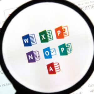 Microsoft Office applications on the web under magnifying glass.