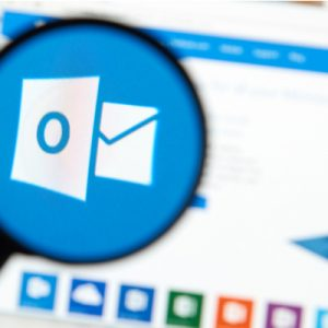 Microsoft Office Outlook on the web under magnifying glass.