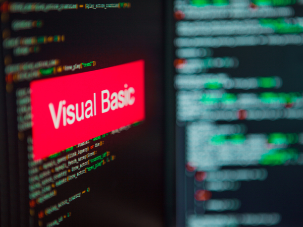 Visual Basic inscription on the background of computer code