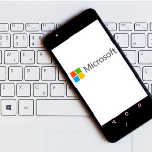 Microsoft Corporation logo is displayed on a smartphone.